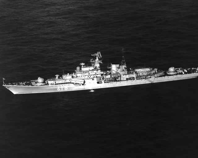 An aerial port beam view of the Soviet SOVREMENNYY class guided missile destroyer (DDG-618) at anchor