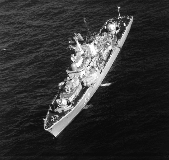 An aerial port bow view of the Soviet SOVREMENNYY class guided missile destroyer (DDG-618) at anchor