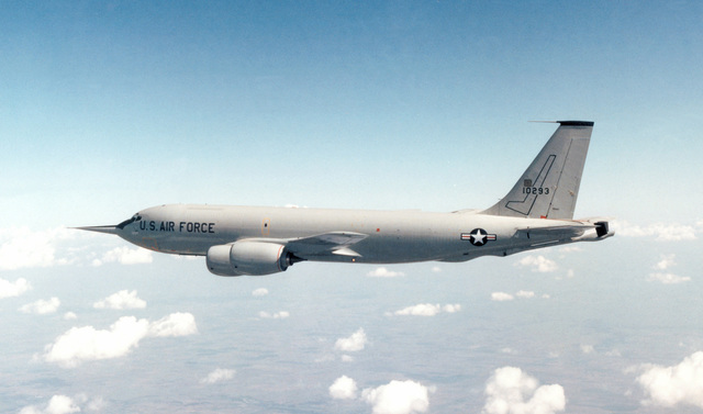 An air-to-air left side view of a KC-135R Stratotanker aircraft retrofitted with the new CFM-56