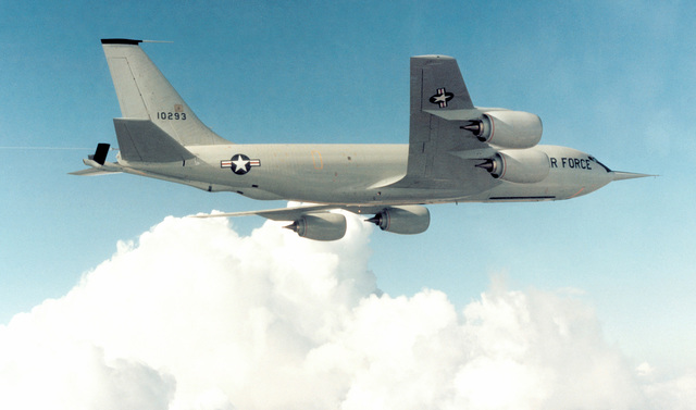 An air-to-air right side view of a KC-135R Stratotanker aircraft retrofitted with the new CFM-56 engine