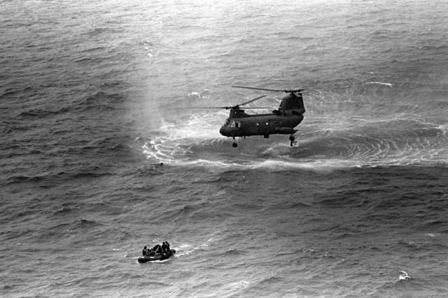 Marines from 1ST Reconnaissance Battalion go through water training by using a rubberized reconnaissance boat and a CH-46 Sea Knight helicopter to pick them up out of the water. The Marines use a rope ladder to climb aboard the helicopter