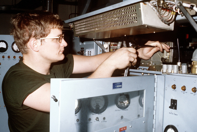 SSGT John Blotnick works on a power amplifier at the communication station