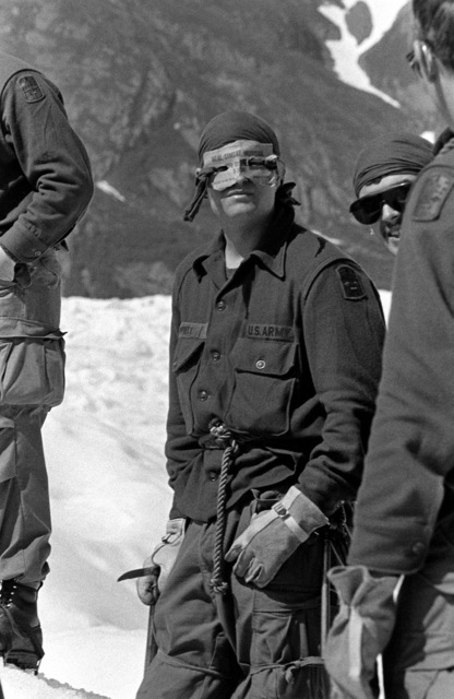 SPC Paul Chappell, center, wears eye protection made from a C-ration container to prevent snow blindness while training on Sheridan Glacier