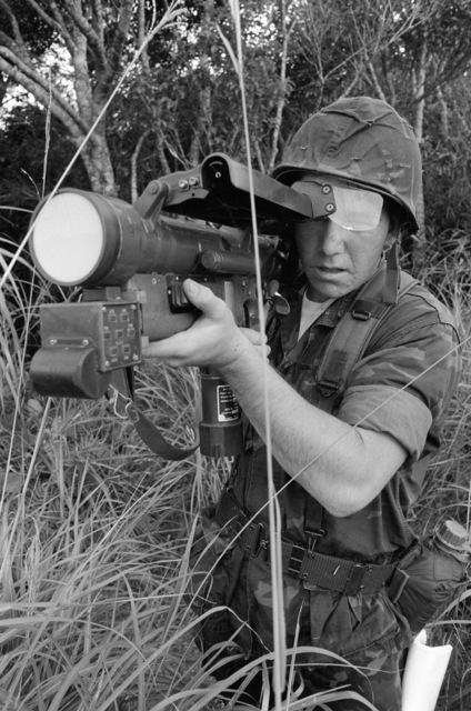 During his field training, PFC Ernest Sanchez carefully sights in on his target with the XM-76 heat seeking training weapon