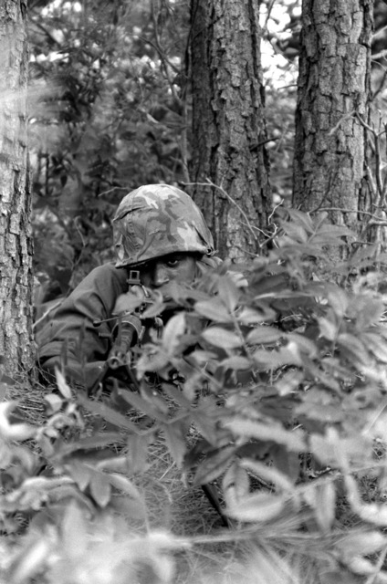 PFC. Michael Harris mans a concealed M-60 machine gun during annual training exercises for the Pennsylvania National Guard, A Troop, First Squadron, 104th Cavalry of Philadelphia Center City. The 104th Cavalry is the nations oldest active military unit