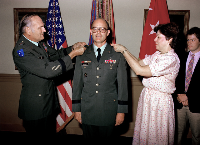 BGEN Victor J. Hugo Jr., presents the Legion of Merit to LCOL John L. Novotny. Attending the ceremony are LCOL Novotny's wife Susan, and son Johnnie, at a ceremony held at the Pentagon