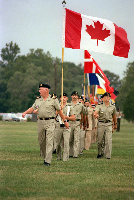 The Canadian delegation to the Congress of the International Organization of Reserves marches to the parade ground during the opening ceremonies
