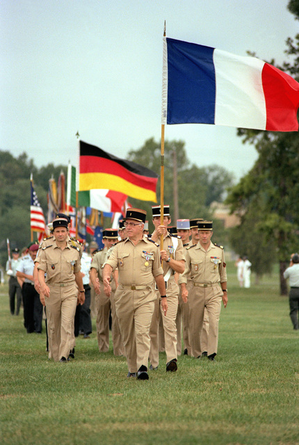 The French delegation to the Congress of the International Organization of Reserves marches to the parade ground during the opening ceremonies