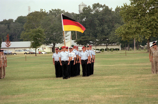 The German delegation to the Congress of the International Organization of Reserves stands at attention on the parade ground during opening ceremonies