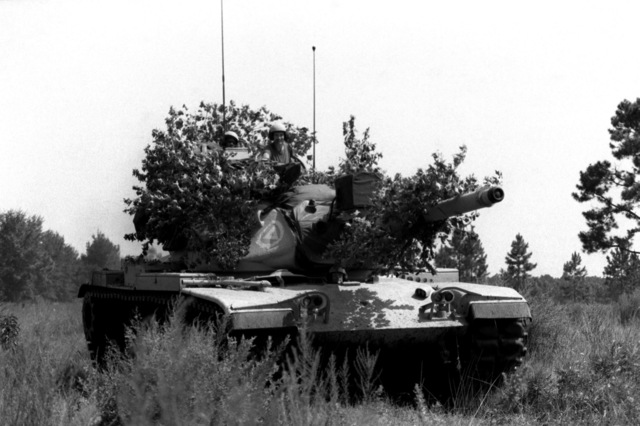 "Members of Co. A, 1ST Bn., 121st Inf., prepares to ""attack"" Co. C, 1ST Bn., 108th Armor, 48th Bde., during the annual Georgia Army National Guard training. A Company is using an M-60A3 tank"