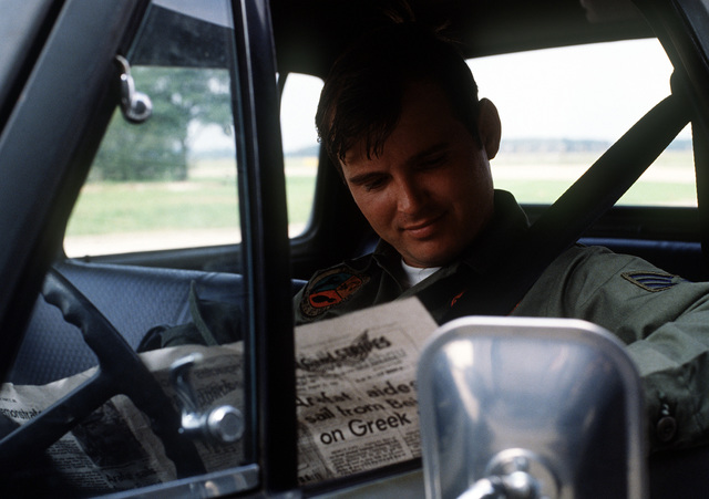 SSGT Tom Walsh takes a break and reads a Stars and Stripes newspaper in his truck during Reforger-Crested Cap II