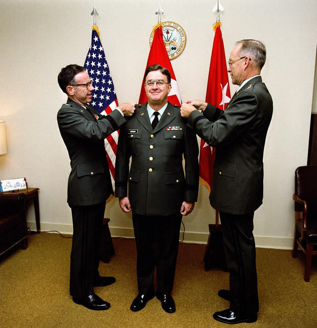 LGEN Maxwell R. Thurman pins the second star on BGEN Mack J. Morgan Jr., during a promotion ceremony at the Pentagon. Assisting in Morgan's promotion to major general is MGEN William R. Berkman, right, chief of Army Reserve