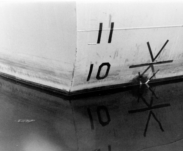 A view of the aft starboard draft marks on the hull of the PCG-612 class patrol chaser, missile, hull number 616 during inclining experiments