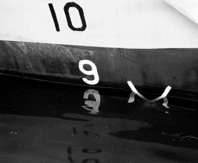 A view of the forward starboard draft marks on the hull of the PCG-612 class patrol chaser, missile, hull number 616 during inclining experiments