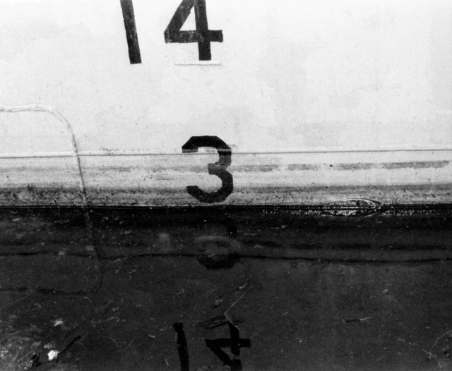 A view of the midship port draft marks on the hull of the PCG-612 class patrol chaser, missile, hull number 616 during inclining experiments