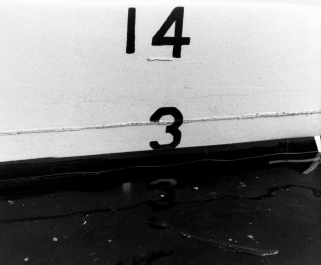 A view of the midship starboard draft marks on the hull of the PCG-612 class patrol chaser, missile, hull number 616 during inclining experiments