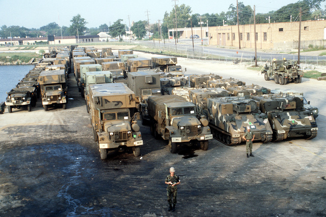 Army vehicles in the staging area prior to being loaded aboard a civilian transport for shipment to Europe. The vehicles are part of a 28,000-ton sealift by the Military Sealift Command to supply equipment to exercise Reforger