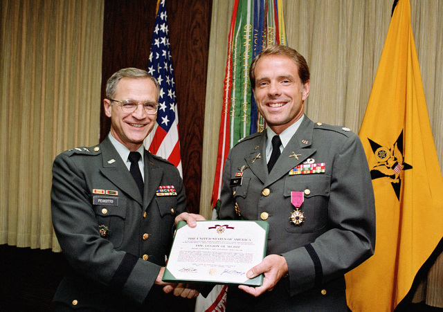 LGEN Ernest D. Peixotto, comptroller of the Army, presents the Legion of Merit to LCOL Thomas S. Raley, program manager for Economics, Efficiencies, and Management Improvements, at the Pentagon