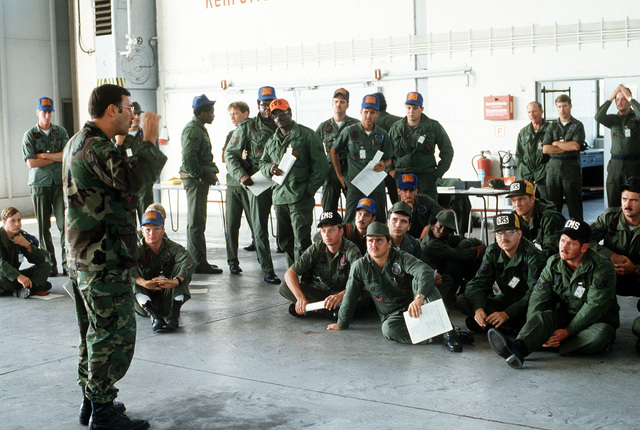 After their arrival, Air Force personnel receive an orientation talk as they wait in an in-processing line to begin their participation in Reforger-Crested Cap I