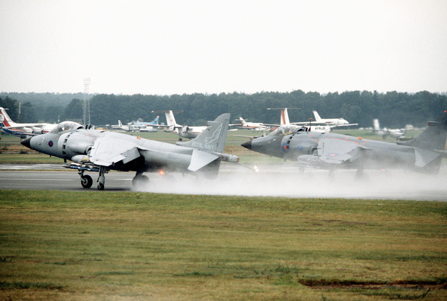 A left rear view of two British Royal Navy AV-8 Sea Harrier vertical take-off/landing (VTOL) aircraft prior to a demonstrate flight at the Farnborough Air Show