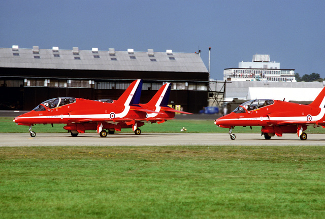 A left side view of Royal Air Force Hawk T. aircraft used by the Red Arrows aerial demonstration team performing at the Farnborough Air Show