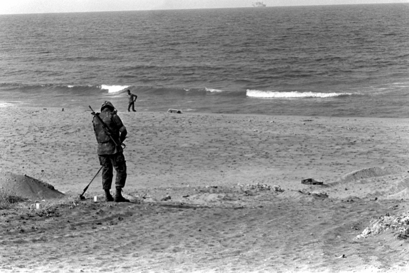 A member of an explosive ordnance disposal team uses a metal detector to check for mines on the beach. U.S. Marines have been assigned to Lebanon as part of a multinational peacekeeping force after a confrontation between Israeli forces and the Palestine Liberation Organization