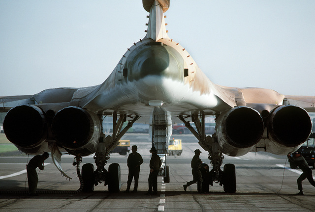 A rear view of the B-1 bomber aircraft as preflight maintenance is performed at the Farnborough Air Show