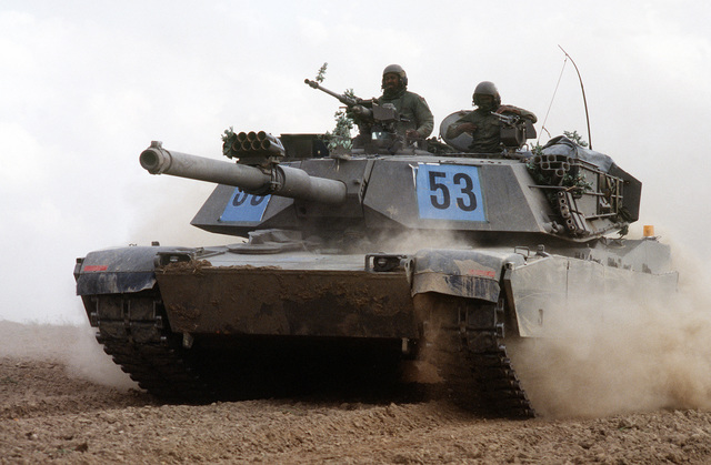 A U.S. Army M1 Abrams tanks kicks up a cloud of dust in the German countryside while participating in REFORGER '82, the multi-national military training exercise. Exact Date Shot Unknown