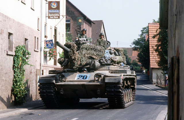 A U.S. Army M551 Sheridan tanks maneuvers through a narrow German village street while participating in REFORGER '82, the multi-national military training exercise. Exact Date Shot Unknown
