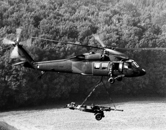 A U.S. Army UH-60A Black Hawk helicopter is used to airlift an M-102 Howitzer to a new operation area. This activity is a part of Exercise Reforger-Carbine Fortress