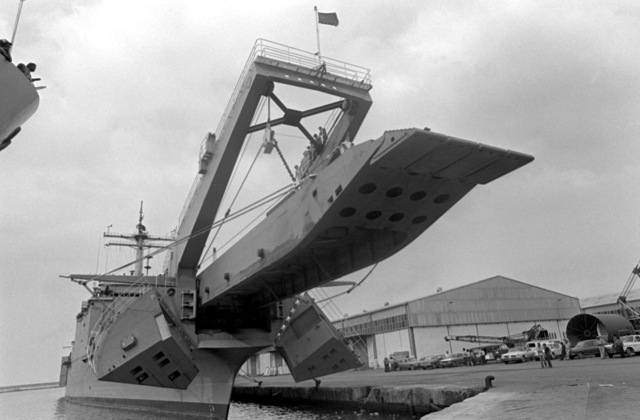 A view of the tank landing ship USS SAGINAW (LST-1188) lowering its landing ramp. The ship will disembark vehicles to be used by Marines assigned to Lebanon as part of a multinational peacekeeping force after a confrontation between Israeli forces and the Palestine Liberation Organization