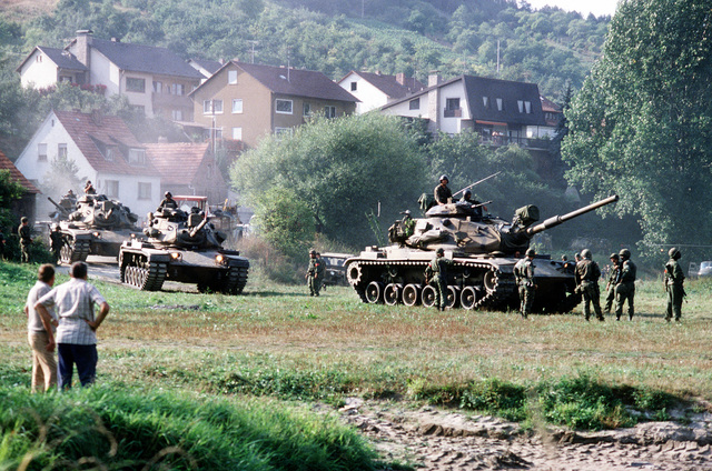 Against a backdrop of a German village, U.S. Army M551 Sheridan tanks maneuver for a river crossing during, REFORGER '82, the multi-national military training exercise. Exact Date Shot Unknown