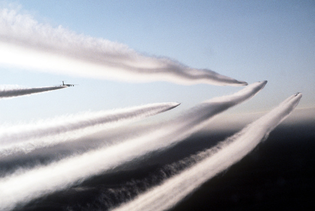 Air to air view of contrails from five C-141B Starlifters enroute to Germany, from the United States, for a drop of U.S. Army paratroopers, participating in REFORGER '82, the multi-national military training exercise. Exact Date Shot Unknown