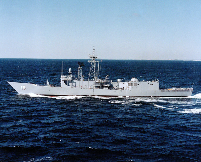 An aerial port beam view of the guided missile frigate USS CLIFTON SPRAGUE (FFG 16) underway