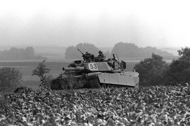 """An Army M-1 Abrams tank, assigned to the 2nd Bn., 64th Armor, 3rd Inf. Div., Schweinfurt, West Germany, is part of the """"friendly forces"""" on the defensive during Carbine Fortress, part of exercise Reforger '82"""
