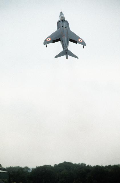 An AV-8 Sea Harrier vertical take-off/landing (VTOL) aircraft demonstrates a vertical climb during the Farnborough Air Show