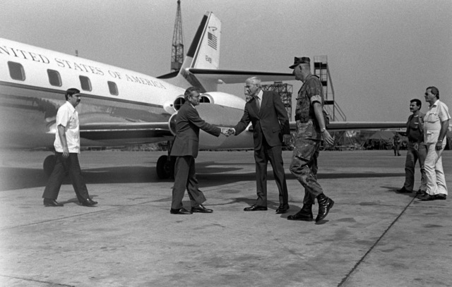 Assistant Secretary of Defense Frank Carlucci, left, is greeted by American Ambassador to Lebanon, Robert Sherwood Dillon, and Colonel James M. Mead upon his arrival at Beirut International Airport. Marines from the 32nd MarIne Amphibious Unit have been deployed here to participate in a multinational peacekeeping operation