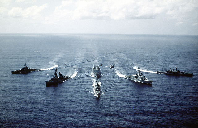Bow view of the ships comprising the Standing Naval Force Atlantic underway. The ships are from left to right: FGS AUGSBURG (F-222), USS SELLERS (DDG-11), HNLMS VAN NES (F-805), HMCS IROQUOIS (DDH-280) and HMS DANAE (F-47)