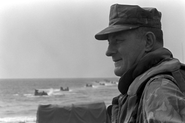 COL James M. Mead, commander of the 32nd Marine Amphibious Unit, watches as U.S. Marines come ashore in amphibious vehicles. U.S. Marines have been assigned to Lebanon as part of a multinational peacekeeping force after a confrontation between Israeli forces and the Palestine Liberation Organization