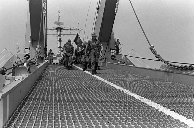 COL James M. Meade, commander of the 32nd Marine Amphibious Unit, leads U.S. Marines down the bow ramp of the tank landing ship USS MANITOWOC (LST-1180). The Marines are part of a multinational peacekeeping force assigned to Lebanon after a confrontation between Israeli forces and the Palestine Liberation Organization