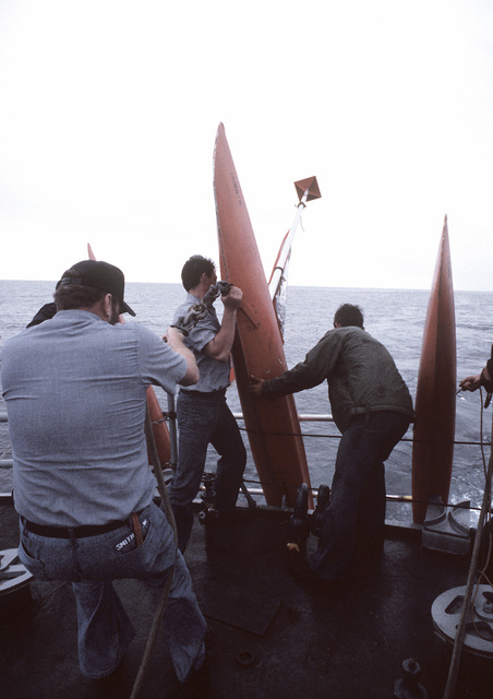 Crewmen prepare to launch a tow target from the aft deck of the guided missile destroyer USS KING (DDG-41) during exercise Unitas XXI