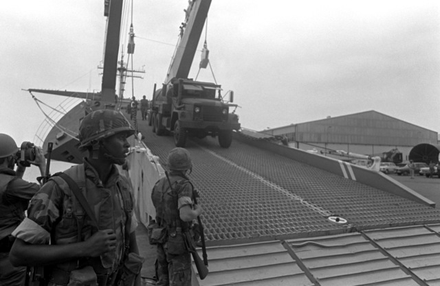 Marine vehicles roll down the bow ramp of the tank landing ship USS SAGINAW (LST-1188). The vehicles will be used by U.S. Marines assigned to Lebanon as part of a multinational peacekeeping force after a confrontation between Israeli forces and the Palestine Liberation Organization