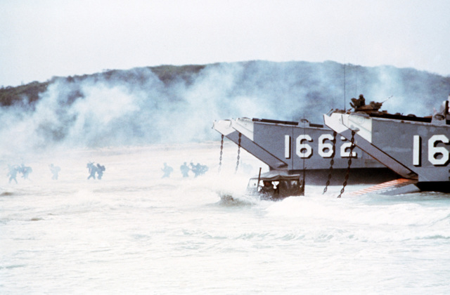 Marines and equipment are offloaded from Utility Landing Craft (LCU-1662 & 1663), as they approach the beach during Operation Ocean Venture '82