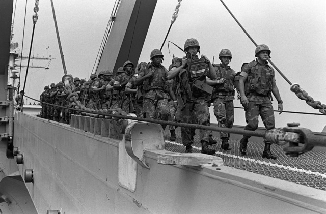 Marines from the 32nd Marine Amphibious Unit walk down the bow ramp of the tank landing ship USS MANITOWOC (LST-1180). The Marines are part of a multinational peacekeeping force assigned to Lebanon after a confrontation between Israeli forces and the Palestine Liberation Organization
