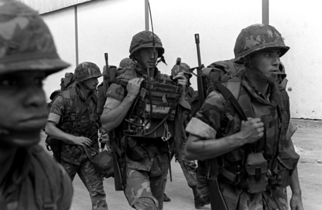 Marines from the 32nd Marine Amphibious Unit walk toward their quarters after leaving the tank landing ship USS MANITOWOC (LST-1180). The Marines are part of a multinational peacekeeping force assigned to Lebanon after a confrontation between Israeli forces and the Palestine Liberation Organization