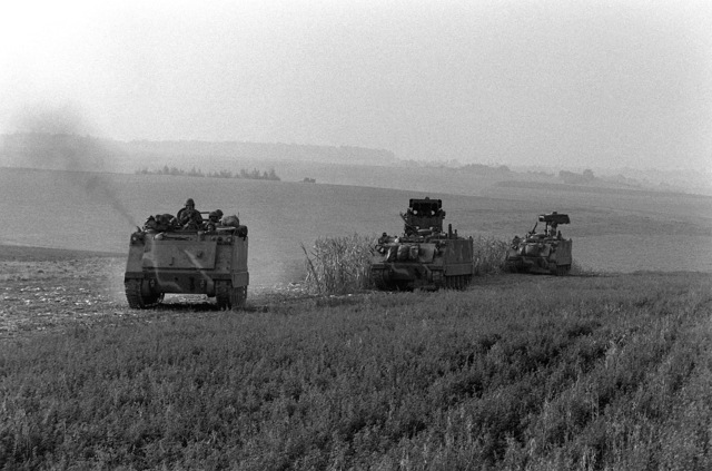 Members of the 1ST Battalion, 28th Infantry (Blue Forces), travel in a tactical formation in armored personnel carriers. They are a part of Exercise Reforger '82