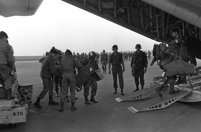 Members of the 1ST Bn., 28th Inf. Regt., 1ST Inf. Div., board an HC-130 Hercules aircraft for a flight to Karlsruhe to participate in Exercise Reforger '82