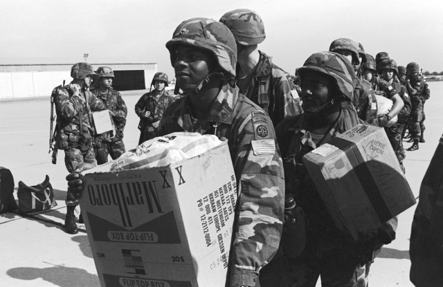 Members of the 82nd Airborne Division from Fort Bragg NC, line up to board a Boeing 747 aircraft for the trip home after their participation in the AUTUMN FORGE Exercise CARBINE FORTRESS, part of NATO Exercise REFORGER '82, held annually in West Germany