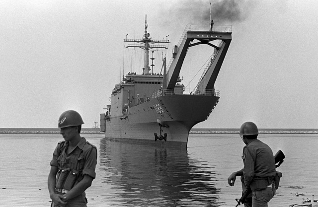 Port bow view of the tank landing ship USS Saginaw (LST-1188) approaching the pier. The ship will disembark vehicles to be used by U.S. Marines assigned to Lebanon as part of a multinational peacekeeping force after a confrontation between Israeli forces and the Palestine Liberation Organization