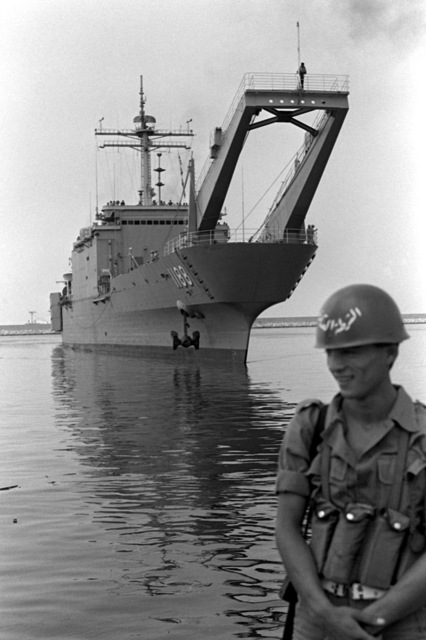 Port bow view of the tank landing ship USS SAGINAW (LST-1188) approaching the pier. The ship will disembark vehicles to be used by Marines assigned to Lebanon as part of a multinational peacekeeping force after a confrontation between Israeli forces and the Palestine Liberation Organization